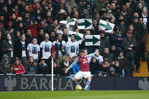 Aston Villa fans try to help end a 10-hour wait for a goal